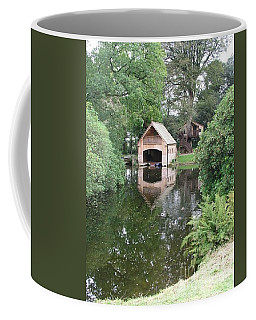 Boathouse On Lake Coffee Mug by Bev Conover