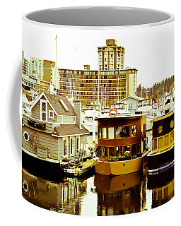 Coffee Mug featuring the photograph Boathouses by Eti Reid