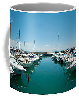 Boats Docked In The Small Harbor Coffee Mug