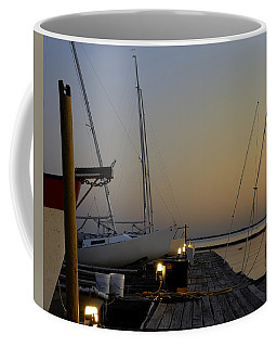 Coffee Mug featuring the photograph Boats Moored To Pier At Sunset by Charles Beeler
