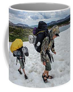 Boys Cross A Snowfield Above Five Point Coffee Mug