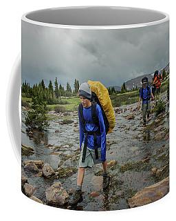 Boys Cross Streams During A Backpack Coffee Mug