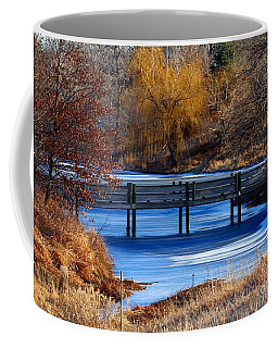 Coffee Mug featuring the photograph Bridge Over Icy Waters by Elizabeth Winter