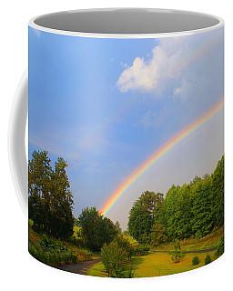 Coffee Mug featuring the photograph Bright Rainbow by Kathryn Meyer