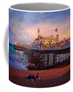 Coffee Mug featuring the photograph Brighton's Palace Pier At Dusk by Chris Lord