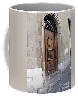 Coffee Mug featuring the photograph Brown Door by Arlene Carmel