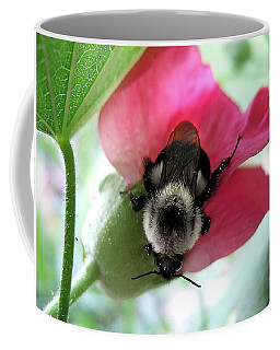Bumble Bee On A Hollyhock Bloom Coffee Mug by Louise Kumpf