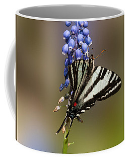Coffee Mug featuring the photograph Butterfly Delight by Lara Ellis