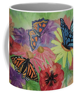 Coffee Mug featuring the painting Butterfly Garden by Ellen Levinson