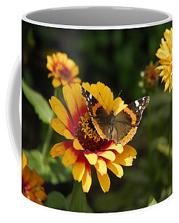Butterfly On Flower Coffee Mug by Charles Beeler