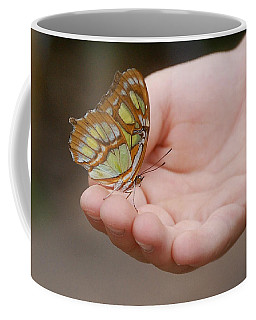 Coffee Mug featuring the photograph Butterfly On Hand by Leticia Latocki