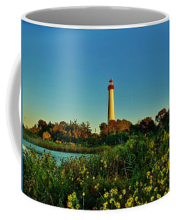 Cape May Lighthouse Above The Flowers Coffee Mug