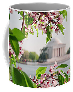 Coffee Mug featuring the photograph Cherry Blossoms And The Jefferson Memorial by Mitchell R Grosky