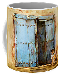 Child Sitting In Old Zanzibar Doorway Coffee Mug