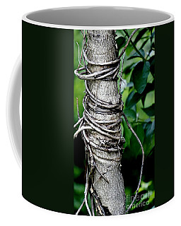 Coffee Mug featuring the photograph Choke by Lilliana Mendez