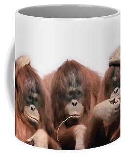 Close-up Of Three Orangutans Coffee Mug