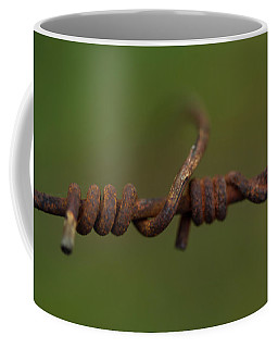 Closeup Of A Connection On A Rusty Wire Coffee Mug