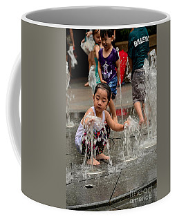 Clothed Children Play At Water Fountain Coffee Mug