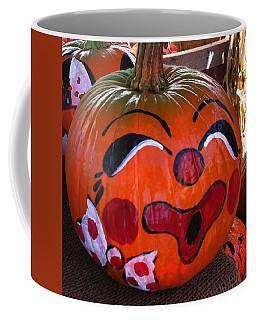 Coffee Mug featuring the photograph Clown Pumpkin by Denyse Duhaime