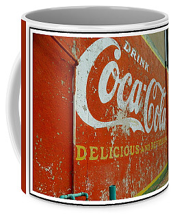 Coffee Mug featuring the photograph Coca-cola On The Army Store Wall by Kathy Barney