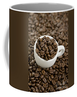 Coffee Mug featuring the photograph Coffe Beans And Coffee Cup by Lee Avison