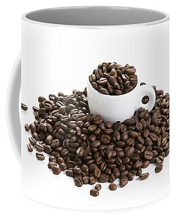 Coffee Mug featuring the photograph Coffee Beans And Coffee Cup Isolated On White by Lee Avison
