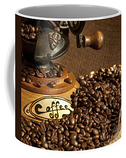 Coffee Mug featuring the photograph Coffee Grinder With Beans by Gunter Nezhoda