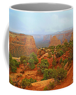 Colorado Natl Monument Snow Coming Down The Canyon Coffee Mug