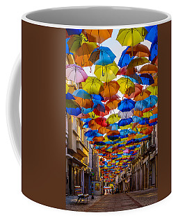 Colorful Floating Umbrellas Coffee Mug by Marco Oliveira