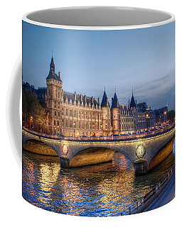 Coffee Mug featuring the photograph Conciergerie And Pont Napoleon At Twilight by Jennifer Ancker