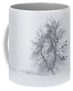 Crows On Tree In Winter Snow Storm Coffee Mug by Peter v Quenter