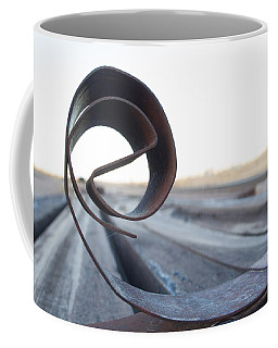 Coffee Mug featuring the photograph Curled Steel by Fran Riley