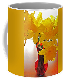 Coffee Mug featuring the photograph Daffodils In Red Vase by Diane Alexander