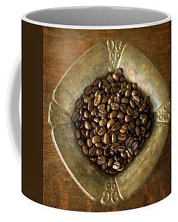 Dark Roast Coffee Beans And Antique Silver Coffee Mug