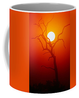 Dead Tree Silhouette And Glowing Sun Coffee Mug