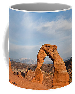 Delicate Arch At Sunset Coffee Mug by Jeff Goulden