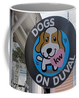 Coffee Mug featuring the photograph Dogs On Duval by Fiona Kennard