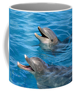 Coffee Mug featuring the photograph Dolphins by Kristine Merc