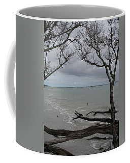 Driftwood On The Beach Coffee Mug by Christiane Schulze Art And Photography