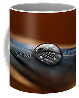 Drop On A Bluejay Feather Coffee Mug by Susan Capuano