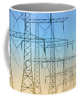 Coffee Mug featuring the photograph Electricity Pylons Standing In A Row by Nick  Biemans