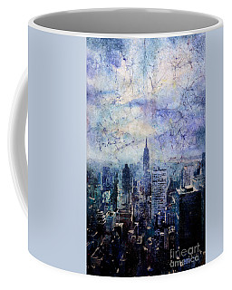 Empire State Building In Blue Coffee Mug by Ryan Fox