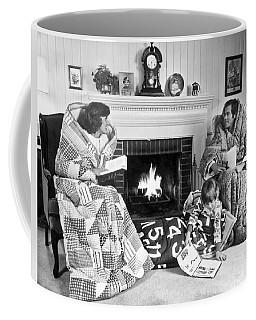 Family Huddled By Fireplace Coffee Mug