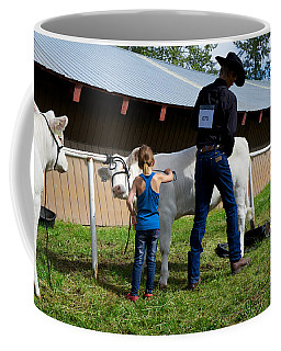 Coffee Mug featuring the photograph Final Touches On The Charolais Heifer  by Mary Lee Dereske