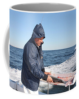 Coffee Mug featuring the photograph First Mate Filleting Fish by John Telfer