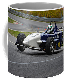 Coffee Mug featuring the photograph Flying Formula by Mike Martin
