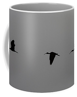 Coffee Mug featuring the photograph Flying Silhouettes by John M Bailey