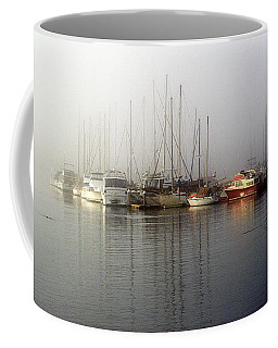 Fog Light In The Harbor Coffee Mug by AJ  Schibig