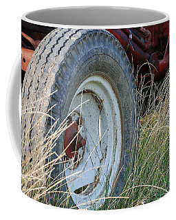 Coffee Mug featuring the photograph Ford Tractor Tire by Jennifer Ancker