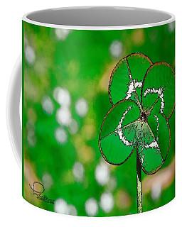 Coffee Mug featuring the digital art Four Leaf Clover by Ludwig Keck